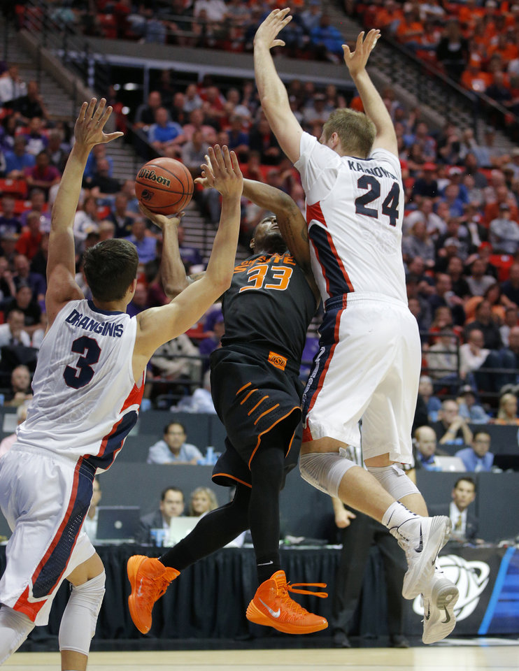 Photo - Oklahoma State's Marcus Smart (33) is fouled Gonzaga's Przemek Karnowski (24) as Kyle Dranginis (3) defends during a second round game of the NCAA men's college basketball tournament at Viejas Arena in San Diego, between Oklahoma State and Gonzaga Friday, March 21, 2014. Gonzaga won 85-77. Photo by Bryan Terry, The Oklahoman