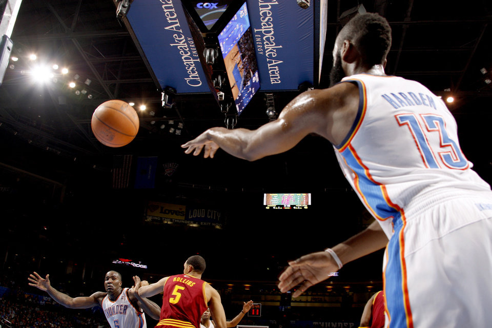 Photo - Oklahoma City's James Harden (13) inbounds the ball to Oklahoma City's Kendrick Perkins (5) as Cleveland's Ryan Hollins (5) defends during the NBA basketball game between the Oklahoma City Thunder and the Cleveland Cavaliers at Chesapeake Energy Arena in Oklahoma City, Friday, March 9, 2012. Photo by Bryan Terry, The Oklahoman