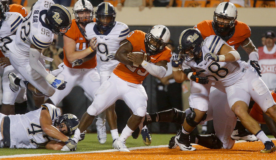 Photo - Oklahoma State's Rennie Childs (23) scores the game winning touchdown during a college football game between the Oklahoma State Cowboys (OSU) and the Pitt Panthers at Boone Pickens Stadium in Stillwater, Okla., Saturday, Sept. 17, 2016. Photo by Chris Landsberger, The Oklahoman