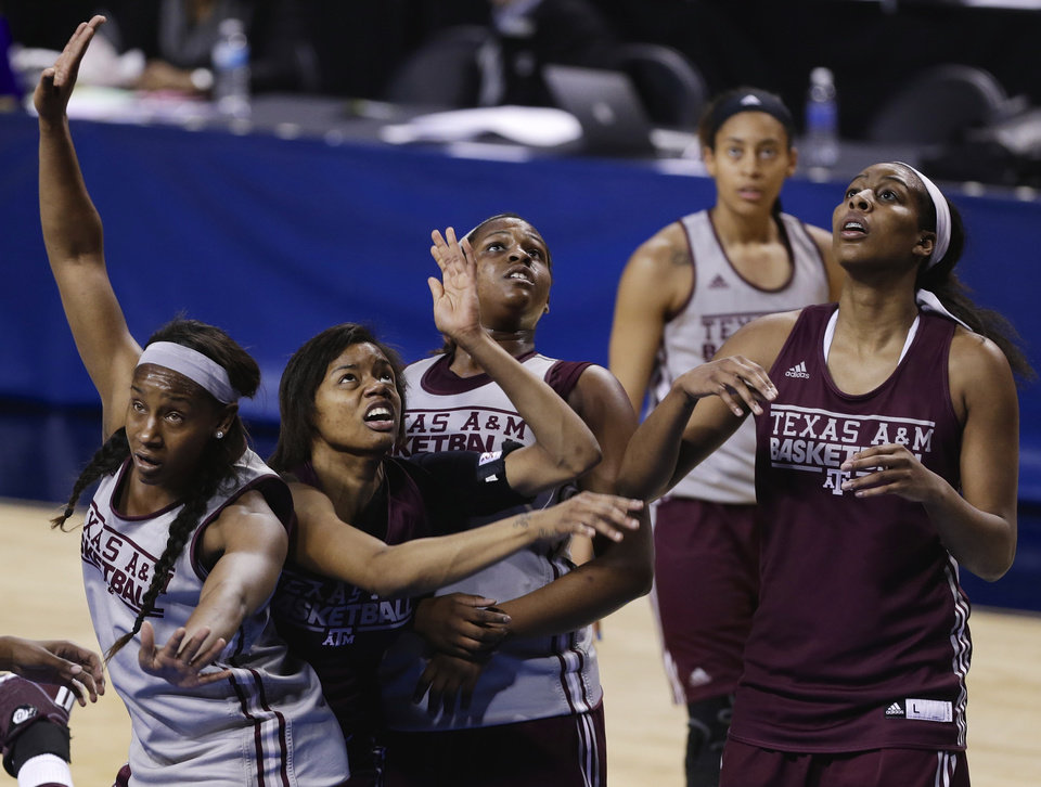 Photo - Texas A&M's Tavarsha Scott-Williams, left, Courtney Williams, second from left, Jada Terry, third from left, and others look to rebound the ball during NCAA college basketball practice in Lincoln, Neb., Friday, March 28, 2014. Texas A&M will play DePaul in an NCAA Lincoln Regional women's semifinal basketball game on Saturday. (AP Photo/Nati Harnik)