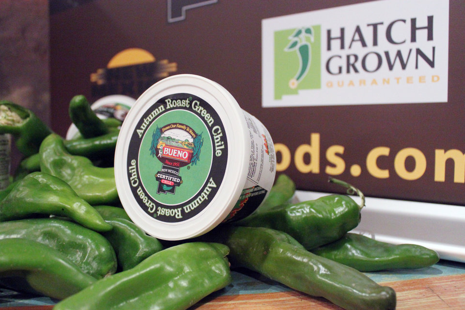 Photo - Fresh green chile and chile products are displayed as state officials announce a new certification program aimed at protecting the reputation and integrity of New Mexico-grown chile during an event at The Range restaurant in Bernalillo, N.M., on Tuesday, Aug. 19, 2014. The restaurant is the first to sign up to participate in the program. (AP Photo/Susan Montoya Bryan)