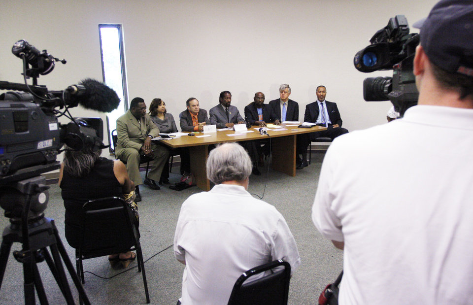 Photo - From left, Minister Reginald Mitchell, Rep. Anastasia Pittman, Franco Cevallos, Anthony Douglas, Roosevelt Milton, Nathaniel Batchelder and Garland Pruitt at a press conference held by the Oklahoma State Conference NAACP Friday, May 29, 2009. Photo by Doug Hoke, The Oklahoman.