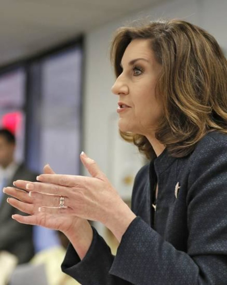 Photo -  State schools Superintendent Joy Hofmeister addresses the Oklahoma Board of Education on Thursday.