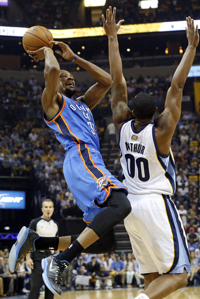 Oklahoma City's Kevin Durant (35) tries to finish his shot after being fouled by Memphis' Darrell Arthur (00) during Game 3 in the second round of the NBA basketball playoffs between the Oklahoma City Thunder and Memphis Grizzles at the FedExForum in Memphis, Tenn.,  Saturday, May 11, 2013. Photo by Nate Billings, The Oklahoman