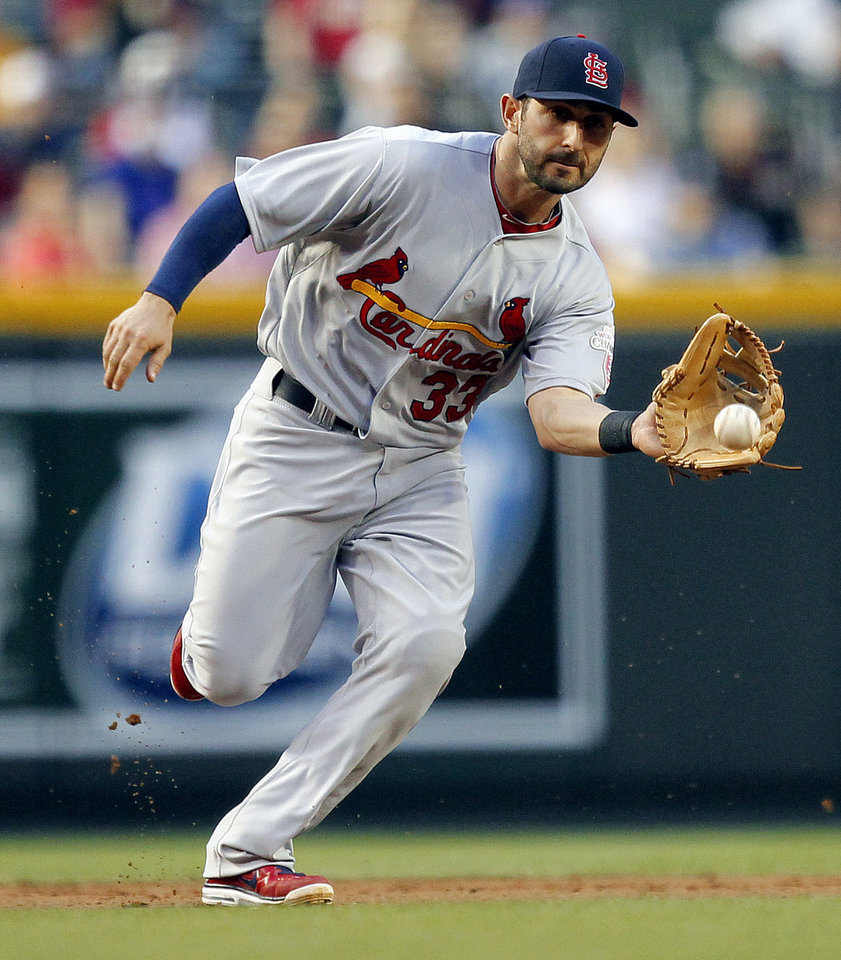 Photo -   St. Louis Cardinals' Daniel Descalso fields a ground ball hit by Arizona Diamondbacks' Paul Goldschmidt during the first inning of a baseball game Tuesday, May 8, 2012, in Phoenix. Goldschmidt was thrown out at first. (AP Photo/Matt York)