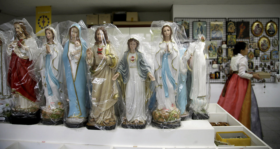 Photo - Religious items are sold in a shop during Pope Francis' visit at the Shrine of Haemi, in South Korea, Sunday, Aug. 17, 2014. (AP Photo/Gregorio Borgia)