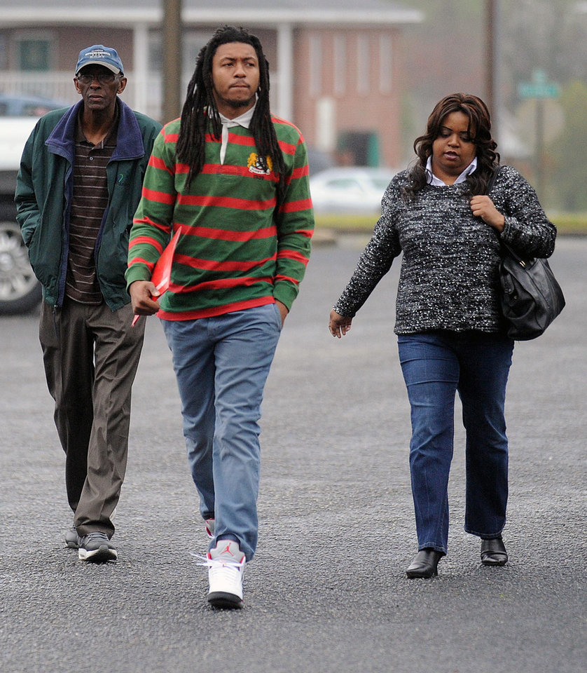 Former Auburn safety Mike McNeil, center, who is charged with armed robbery, arrives for a court appearance on Thursday, April 4, 2013, in Opelika, Ala. (AP Photo/AL.com, Julie Bennett)  MAGAZINES OUT