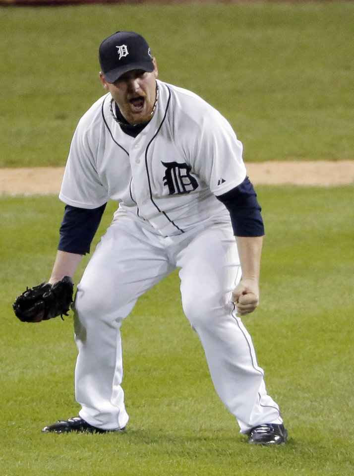 Photo -   Detroit Tigers' Phil Coke celebrates after winning Game 4 of the American League championship series against the New York Yankees Thursday, Oct. 18, 2012, in Detroit. The Tigers move on to the World Series. (AP Photo/Charlie Riedel)