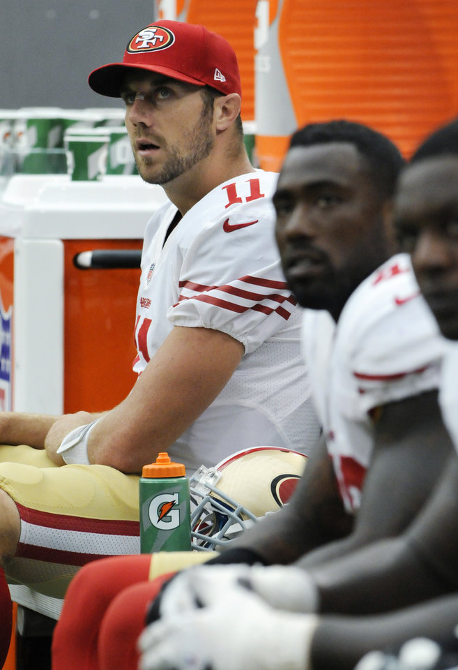 Photo -   San Francisco 49ers quarterback Alex Smith (11) sits on the bench during the second half of an NFL football game against the Minnesota Vikings Sunday, Sept. 23, 2012, in Minneapolis. (AP Photo/Jim Mone)
