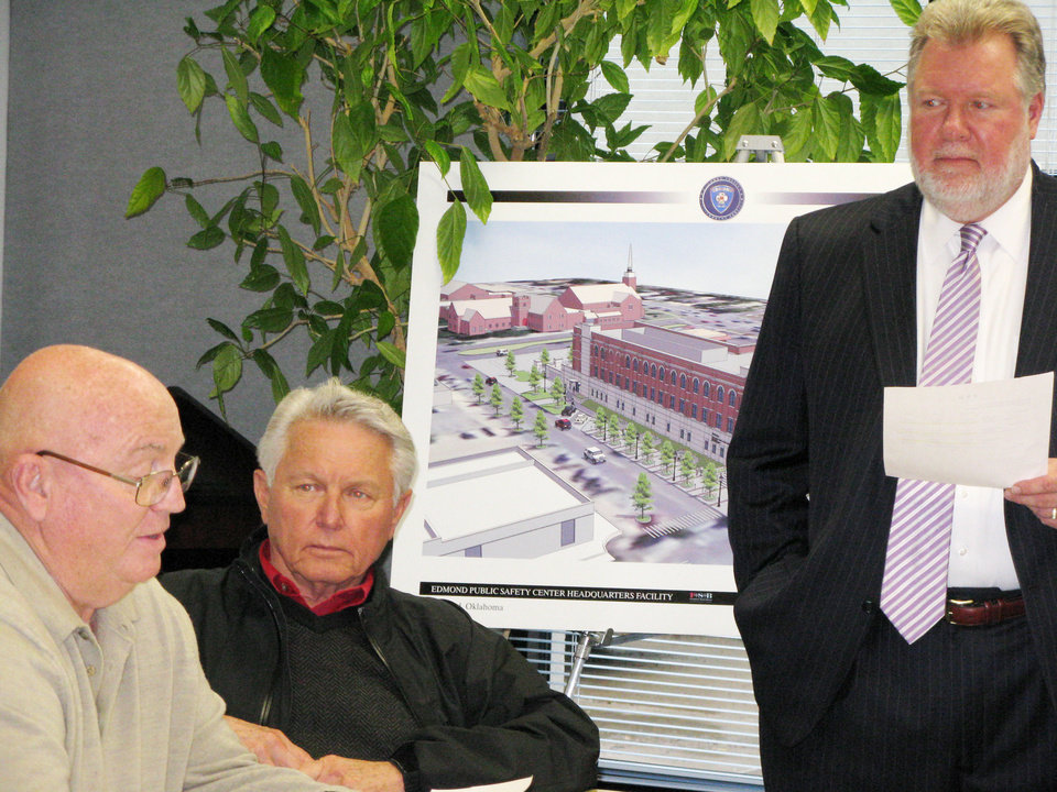 Oscar Majors, left, and Philip McNayr, both with Frankfurt Short Bruza architects, discuss final plans for Edmond's new Public Safety Center. Police Chief Bob Ricks listens to the presentation before the city's Public Safety Center Senior Steering Committee.  PHOTO BY DIANA BALDWIN, THE OKLAHOMAN