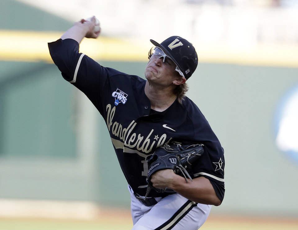 Photo - Vanderbilt's Carson Fulmer throws a pitch in the first inning of Game 3 of the best-of-three NCAA baseball College World Series finals against Virginia, in Omaha, Neb., Wednesday, June 25, 2014. (AP Photo/Nati Harnik)