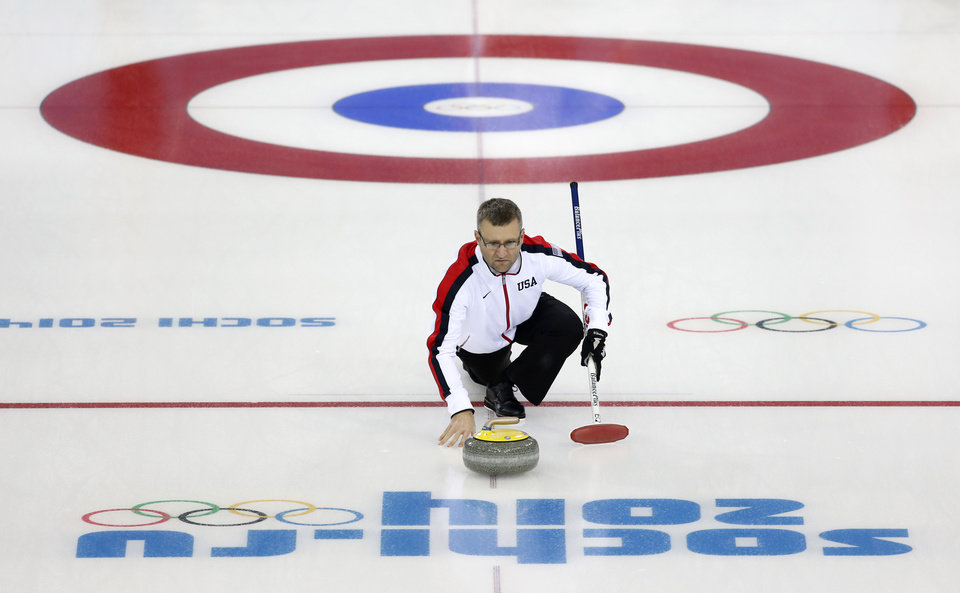 Photo - Craig Brown, an alternate on Team USA, delivers the stone during a men's curling training session the 2014 Winter Olympics, Sunday, Feb. 9, 2014, in Sochi, Russia. (AP Photo/Robert F. Bukaty)