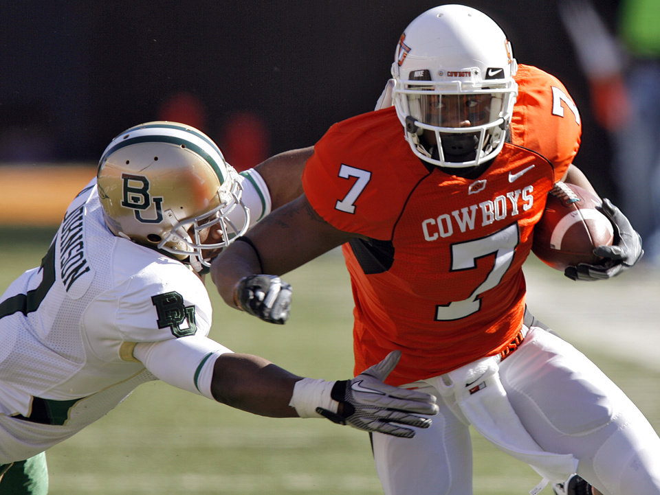 Oklahoma State's Michael Harrison (7) takes the ball up field past Baylor's Antonio Johnson (7) during the college football game between the Oklahoma State University Cowboys (OSU) and the Baylor University Bears at Boone Pickens Stadium in Stillwater, Okla., Saturday, Nov. 6, 2010. Photo by Chris Landsberger, The Oklahoman