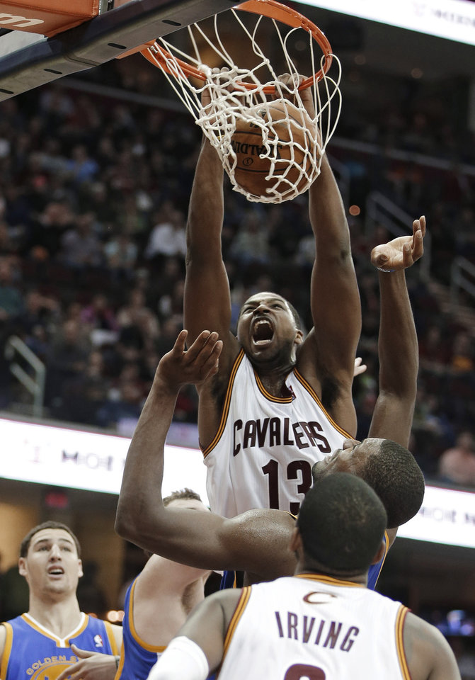Cleveland Cavaliers' Tristan Thompson (13) dunks against the Golden State Warriors in the second quarter of an NBA basketball game Tuesday, Jan. 29, 2013, in Cleveland. (AP Photo/Mark Duncan)