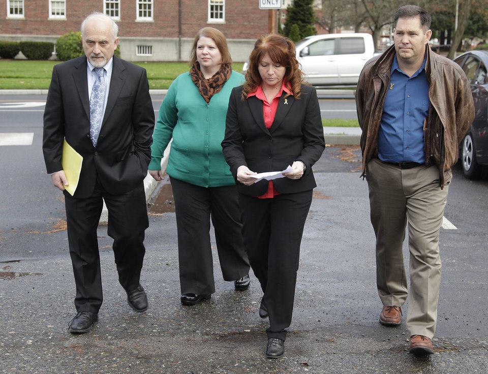 Photo -   Kari Bales, second from left, walks with attorney Lance Rosen, left, her sister, Stephanie Tandberg, second from right, and Tandberg's husband Eric Tandberg, right, as they prepare to to talk to reporters Tuesday Nov. 13, 2012, outside the building housing a military courtroom on Joint Base Lewis McChord in Washington state, where a preliminary hearing ended Tuesday for Kari's husband, U.S. Army Staff Sgt. Robert Bales. Bales is accused of 16 counts of premeditated murder and six counts of attempted murder for a pre-dawn attack on two villages in Kandahar Province in Afghanistan last March. (AP Photo/Ted S. Warren)