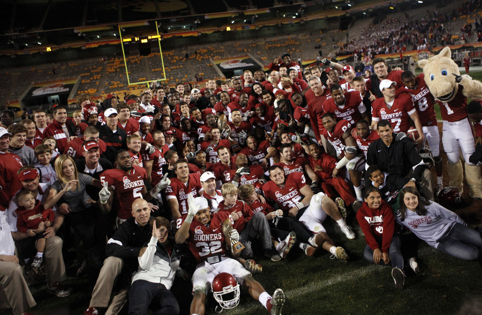 Photo - Oklahoma celebrates the Sooner's win in the Insight Bowl college football game between the University of Oklahoma (OU) Sooners and the Iowa Hawkeyes at Sun Devil Stadium in Tempe, Ariz., Friday, Dec. 30, 2011. Photo by Sarah Phipps, The Oklahoman