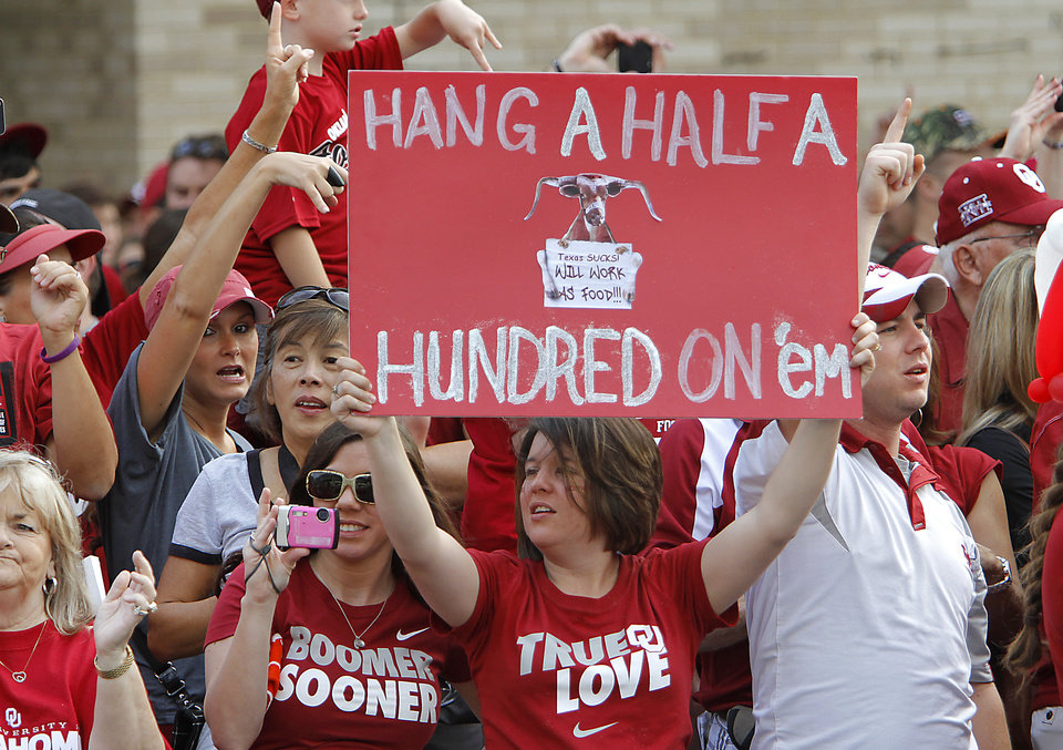 Photo - Oklahoma fans cheer on their team as the Sooners' team busses arrive for the Red River Rivalry college football game between the University of Oklahoma Sooners (OU) and the University of Texas Longhorns (UT) at the Cotton Bowl in Dallas, Saturday, Oct. 8, 2011. Photo by Chris Landsberger, The Oklahoman