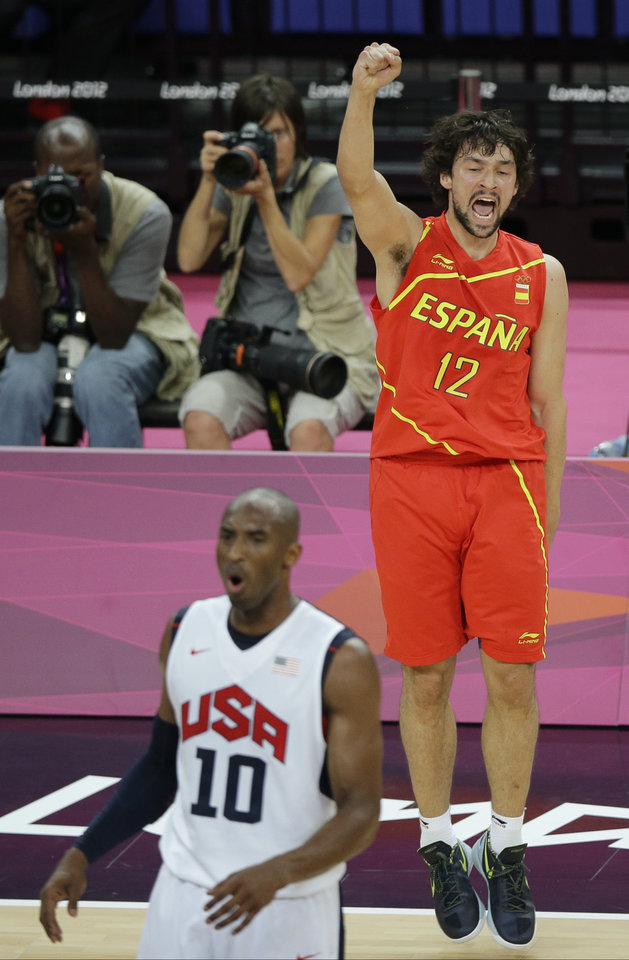 Spain's Sergio Llull reacts behind United States' Kobe Bryant during the men's gold medal basketball game at the 2012 Summer Olympics, Sunday, Aug. 12, 2012, in London. (AP Photo/Matt Slocum)