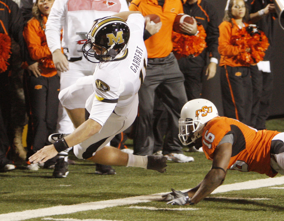 Photo - Perrish Cox (16) knocks Blaine Gabbert out of bounds short of the end zone and a first down during the college football game between Oklahoma State University (OSU) and the University of Missouri (MU) at Boone Pickens Stadium in Stillwater, Okla. Saturday, Oct. 17, 2009.  Photo by Doug Hoke, The Oklahoman