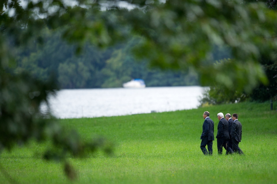 Photo - Foreign Ministers of Russia Sergey Lavrov, Germany Frank-Walter Steinmeier, France Laurent Fabius and Ukraine Pavlo Klimkin, from left, go for a walk before a meeting at the Guesthouse of Foreign Ministry Villa Borsig in Berlin, Sunday, Aug. 17, 2014. (AP Photo/Steffi Loos)