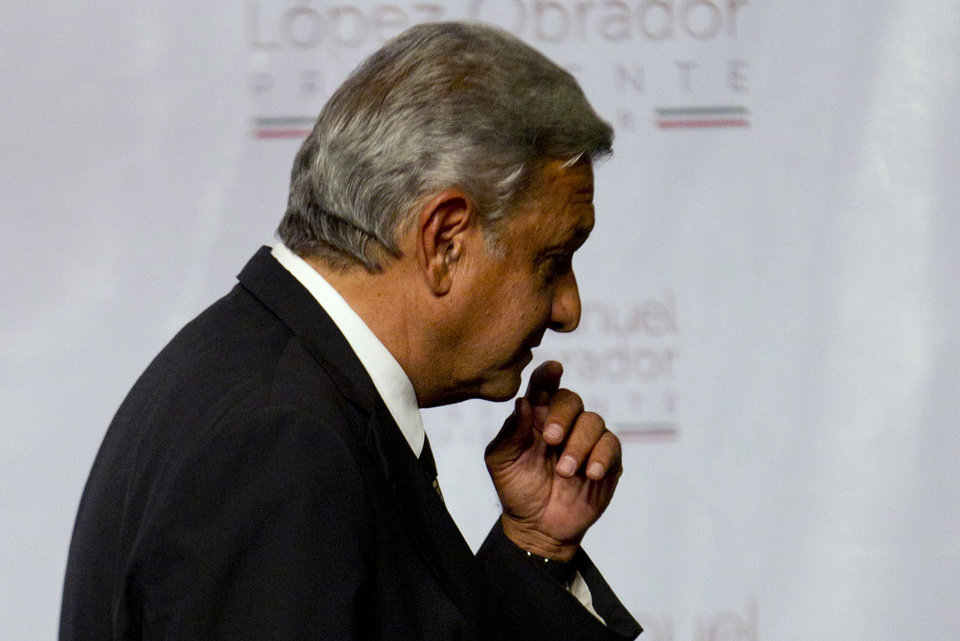 Photo -   Presidential candidate Andres Manuel Lopez Obrador of the Democratic Revolution Party (PRD) leaves the podium after speaking in Mexico City, Sunday, July 1, 2012. Obrador said he won't concede the presidency despite an official preliminary count that shows him losing to former ruling party candidate Enrique Pena Nieto, of the Institutional Revolutionary Party (PRI), and that he would wait for a full count. (AP Photo/Eduardo Verdugo)