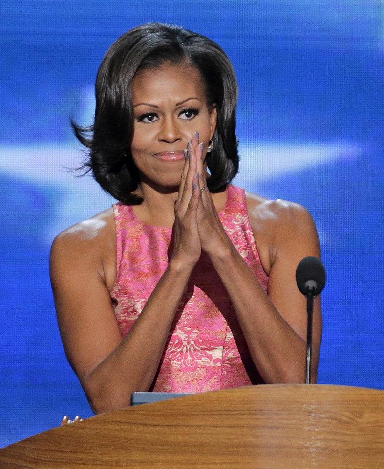 Photo - First Lady Michelle Obama addresses the Democratic National Convention in Charlotte, N.C., on Tuesday, Sept. 4, 2012. (AP Photo/J. Scott Applewhite)  ORG XMIT: DNC194