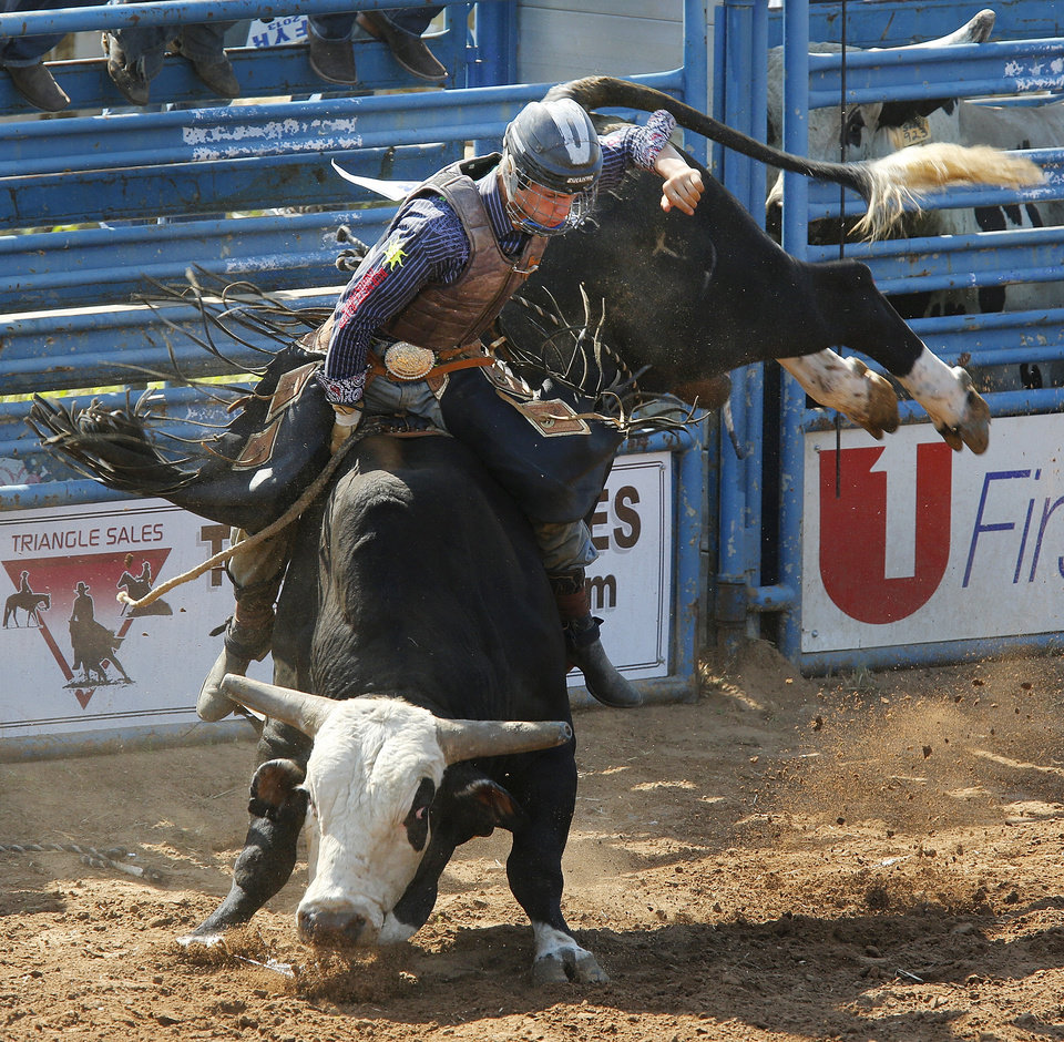 Koal Livingston,Burleson, Texas competes in the bull riding competition in the International Finals Youth Rodeo at the Heart of Oklahoma Expo Center in Shawnee, Monday July 8, 2013. Photo By Steve Gooch, The Oklahoman