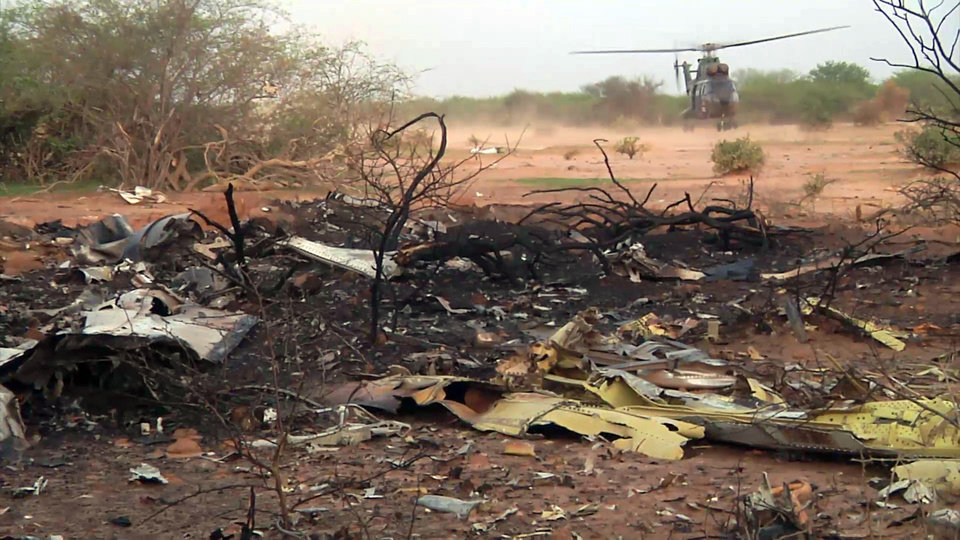 Photo - This photo provided Friday July 25, 2014 by the French army shows a helicopter at the site of the plane crash in Mali. French soldiers secured a black box from the Air Algerie wreckage site in a desolate region of restive northern Mali on Friday, the French president said. Terrorism hasn't been ruled out as a cause, although officials say the most likely reason for the catastrophe that killed all onboard is bad weather. At least 116 people were killed in Thursday's disaster, nearly half of whom were French. (AP Photo/ECPAD)