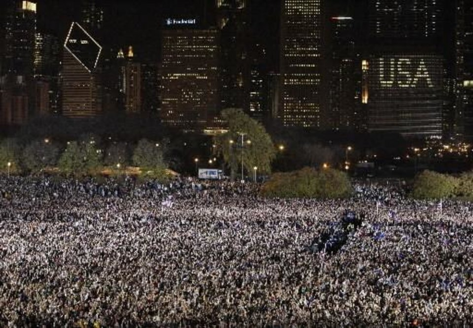 Photo - Supporters cheer as they hear results from television that President-elect Barack  Obama has been elected President of the United States at Grant Park in Chicago, Tuesday night, Nov. 4, 2008. (AP Photo/Alex Brandon)