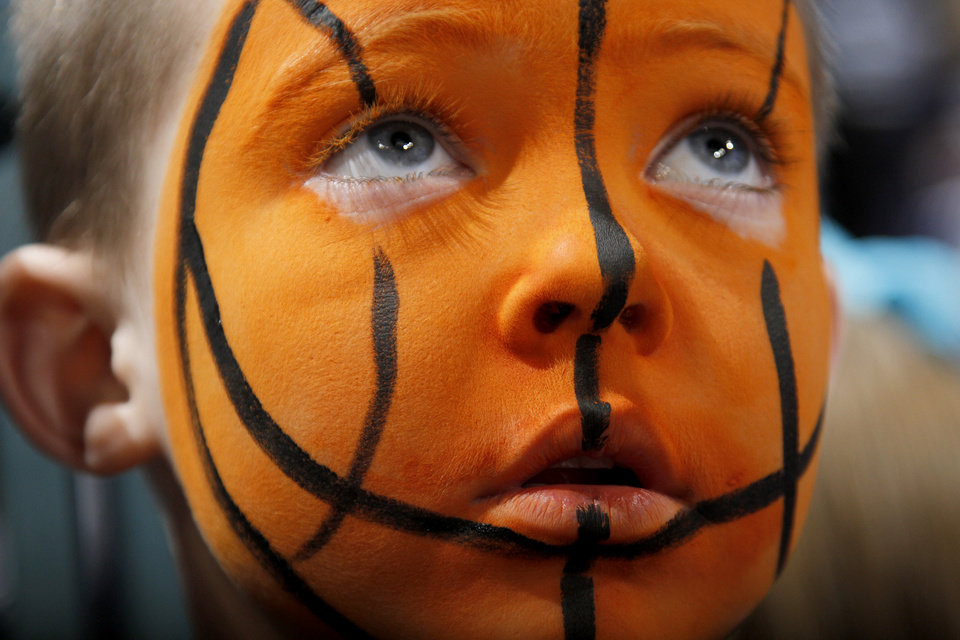 Photo - Hudson Hamar, 6, of Seiling, Okla., waits for the start of the NBA basketball game between the Denver Nuggets and the Oklahoma City Thunder in the first round of the NBA playoffs at the Oklahoma City Arena, Wednesday, April 27, 2011. Photo by Bryan Terry, The Oklahoman