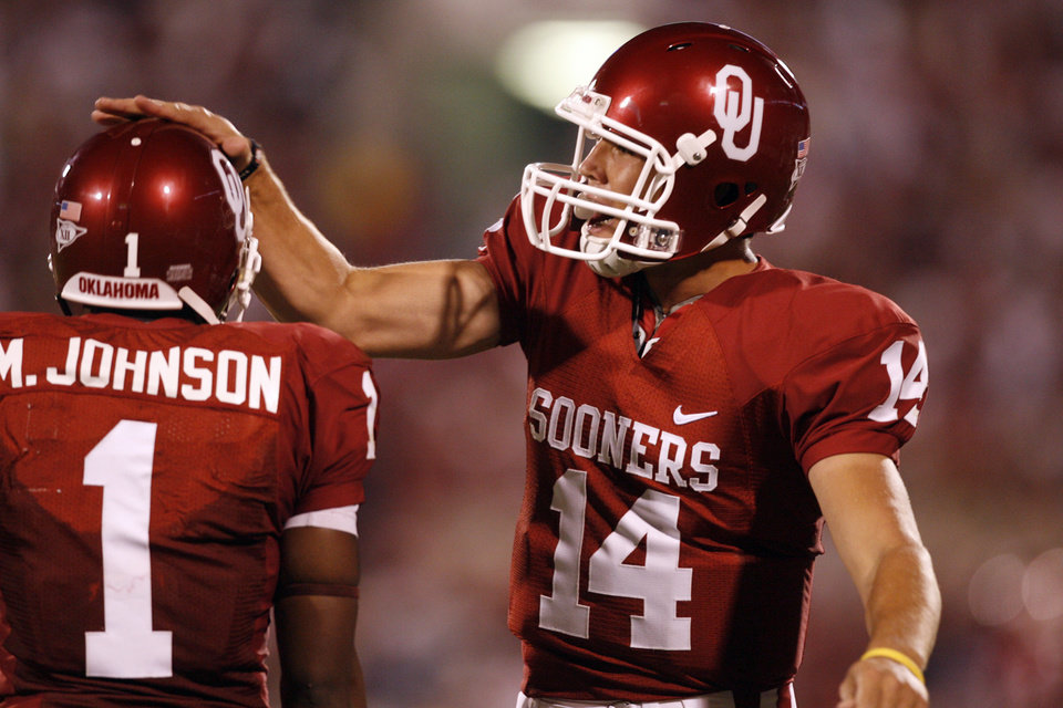 Photo - MANNY JOHNSON / CELEBRATE / CELEBRATION: Sam Bradford pats Manual Johnson on the helmet after their scoring pass completion during the second half of the college football game between the University of Oklahoma Sooners (OU) and Texas Christian University Horned Frogs (TCU) at the Gaylord Family -- Oklahoma Memorial Stadium on Saturday, Sept. 27,  2008, in Norman, Okla.  by Steve Sisney, The Oklahoman ORG XMIT: KOD