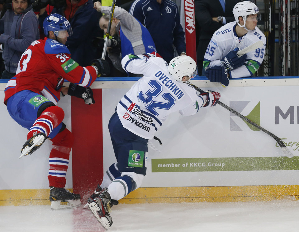 Alexander Ovechkin, right, from Dynamo Moscow collides with Zdeno Chara from Lev Praha during their KHL ice hockey match in Prague, Czech Republic, Tuesday, Oct. 9, 2012. Chara and Ovechkin are among those NHL players who were signed by European clubs because of the NHL lockout. (AP Photo/Petr David Josek)
