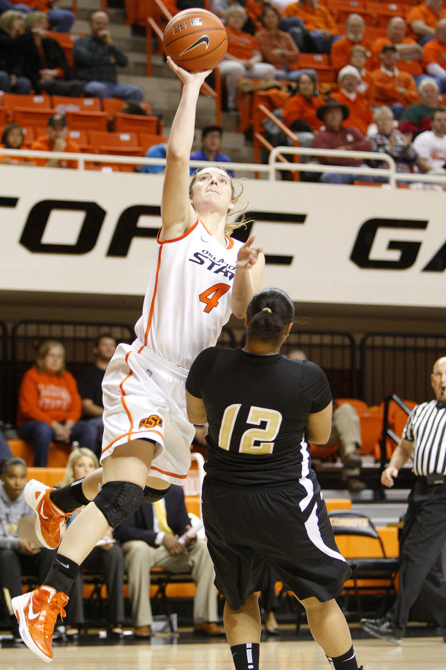 Oklahoma State's Liz Donohoe (4) shoots the ball past Arkansas-Pine Bluff's Victoria White (12) during an NCAA women's college basketball game between Oklahoma State University (OSU) and Arkansas-Pine Bluff at Gallagher-Iba Arena in Stillwater, Thursday, Dec. 22, 2011. Photo by Bryan Terry, The Oklahoman