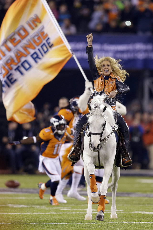 Photo - Thunder leads the Denver Broncos players onto the field before the NFL Super Bowl XLVIII football game against the Seattle Seahawks Sunday, Feb. 2, 2014, in East Rutherford, N.J. (AP Photo/Ben Margot)