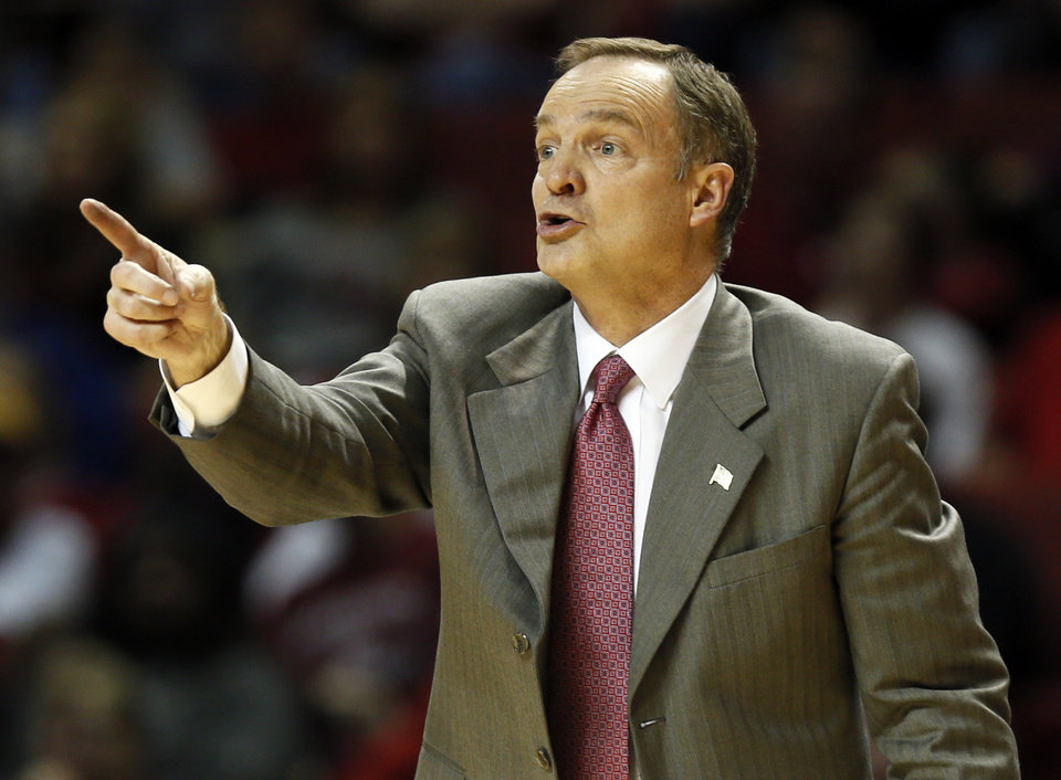 Photo - Oklahoma coach Lon Kruger gives instruction to his team during an NCAA men's college basketball game between Baylor and the University of Oklahoma at Lloyd Noble Center in Norman, Okla., Saturday, Feb. 8, 2014. OU won, 88-72. Photo by Nate Billings, The Oklahoman