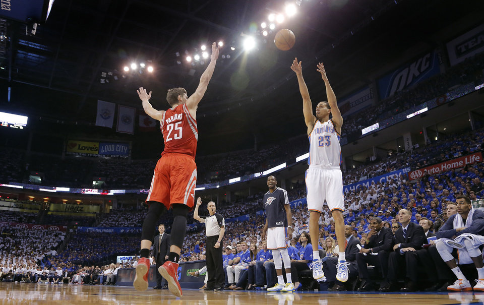 Oklahoma City's Kevin Martin (23) shoots the ball over Houston's Chandler Parsons (25) during Game 2 in the first round of the NBA playoffs between the Oklahoma City Thunder and the Houston Rockets at Chesapeake Energy Arena in Oklahoma City, Wednesday, April 24, 2013. Photo by Chris Landsberger, The Oklahoman