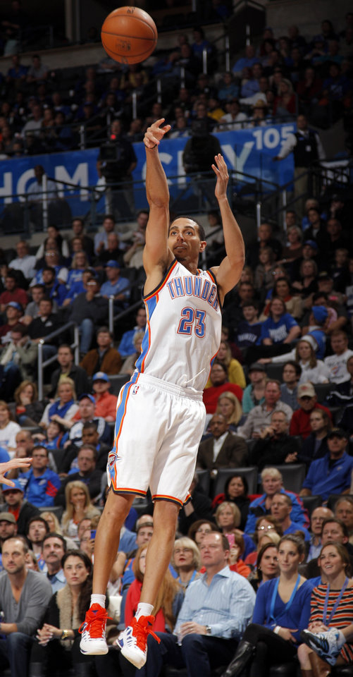 Photo - Oklahoma City's Kevin Martin (23) shoots during the NBA basketball game between the Oklahoma City Thunder and the Cleveland Cavaliers at the Chesapeake Energy Arena, Sunday, Nov. 11, 2012. Photo by Sarah Phipps, The Oklahoman
