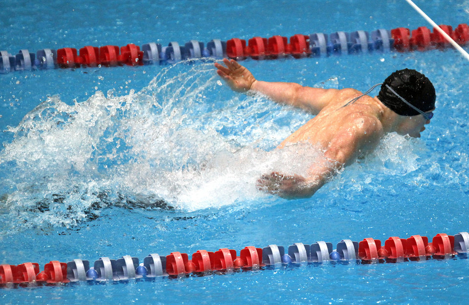Photo - HIGH SCHOOL SWIMMING / STATE CHAMPIONSHIP / OCCC: Dakota Wheeler of Westmoore competes in the Class 6A Boys 100-yard butterfly during the OSSAA State Swimming Championships, Saturday, Feb. 21, 2009, at the OKCCC Aquatic Center in Oklahoma City. PHOTO BY SARAH PHIPPS, THE OKLAHOMAN ORG XMIT: KOD