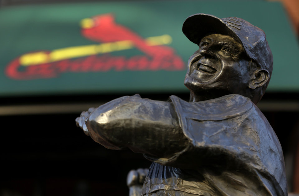 Photo - A statue of former St. Louis Cardinals baseball player Stan Musial stands outside Busch Stadium Sunday, Jan. 20, 2013, in St. Louis. Musial, one of baseball's greatest hitters and a Hall of Famer with the Cardinals for more than two decades, died Saturday, Jan. 19, 2013, the team announced. He was 92. (AP Photo/Jeff Roberson)