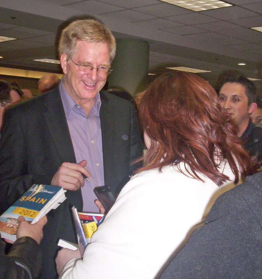 Rick Steves autographs books at Oklahoma Christian University Saturday March 10, 2012. Photo by Kimberly Burk, The Oklahoman