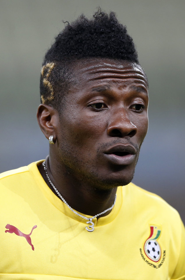 Photo - Ghana's Asamoah Gyan warms up during an official training session the day before the group G World Cup soccer match between Germany and Ghana at the Arena Castelao in Fortaleza, Brazil, Friday, June 20, 2014. (AP Photo/Matthias Schrader)