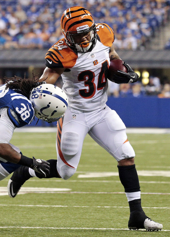 Photo -   Cincinnati Bengals running back Dan Herron (34) tries to get past Indianapolis Colts defensive back Mike Newton in the second half of an NFL preseason football game in Indianapolis, Thursday, Aug. 30, 2012. (AP Photo/AJ Mast)