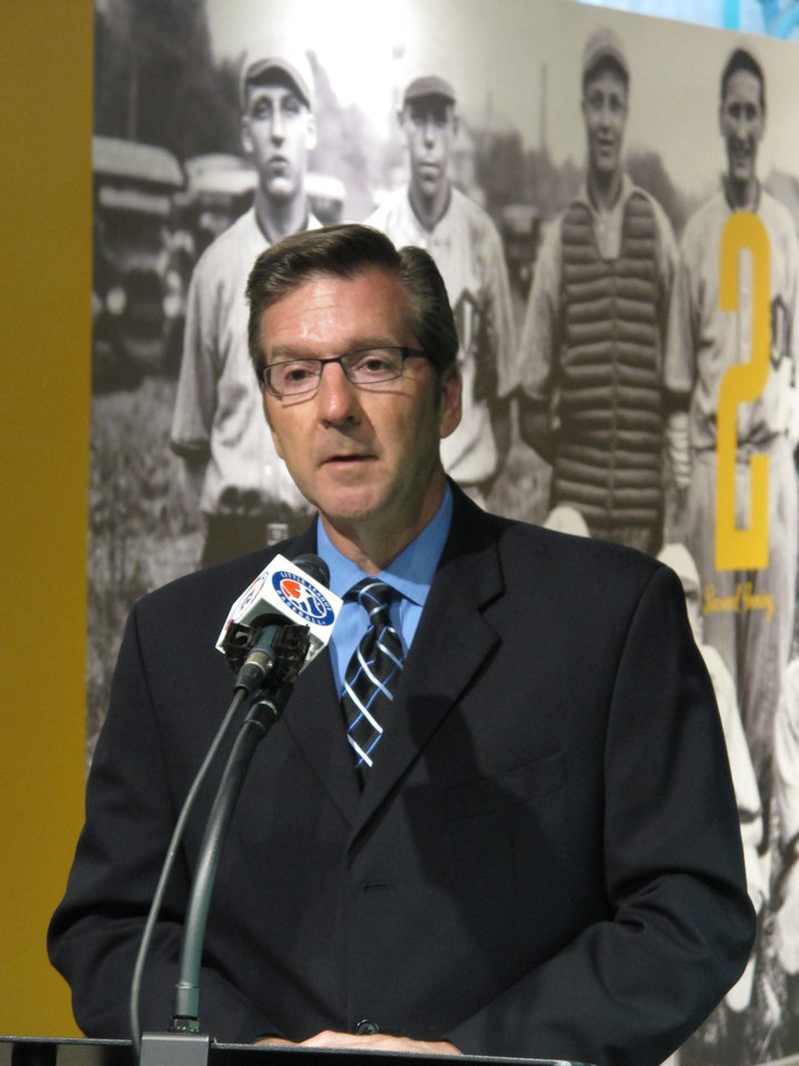 Photo - In this Wednesday, April 24, 2013 photo, Little League International president Stephen Keener speaks at a news conference at the Little League museum in South Williamsport, Pa. Little League announced that the family of program founder Carl Stotz loaned artifacts to display at an exhibit, including the home plate used in the first Little League. (AP Photo/Genaro C. Armas)