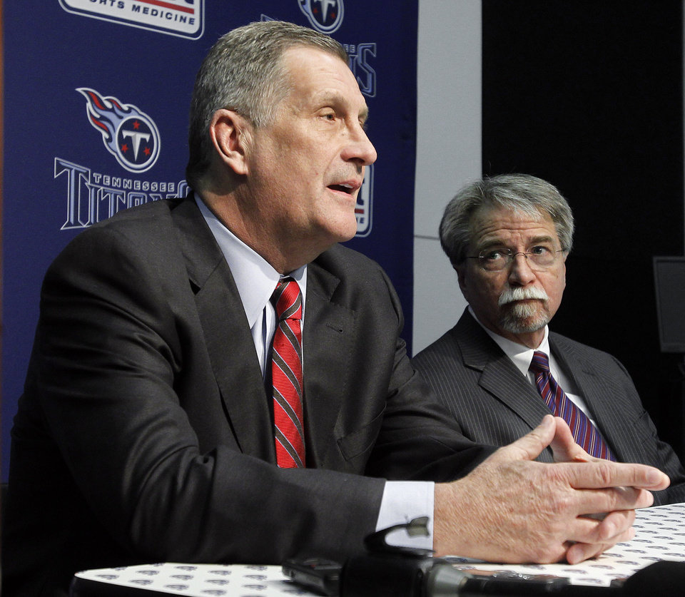 Photo -   Tennessee Titans general manager Mike Reinfeldt, left, and senior executive vice president Steve Underwood, right, answer questions during an NFL football news conference at the team's headquarters on Friday, Jan. 28, 2011, in Nashville, Tenn. The Titans announced on Thursday that Jeff Fisher will not remain as head coach. (AP Photo/Mark Humphrey)