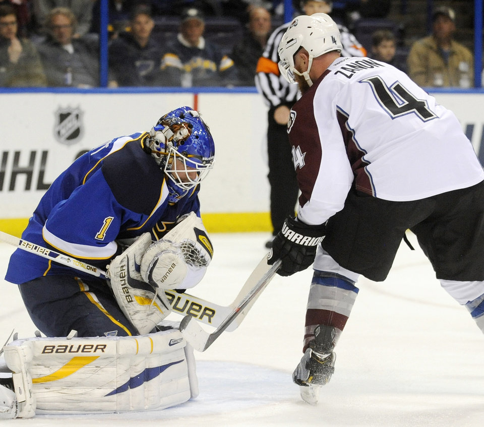 Photo - St. Louis Blues goalie Brian Elliot (1) blocks a shot by Colorado Avalanche's Greg Zanon (4) in the first period of an NHL hockey game Tuesday, April 23, 2013, in St. Louis. (AP Photo/Bill Boyce)