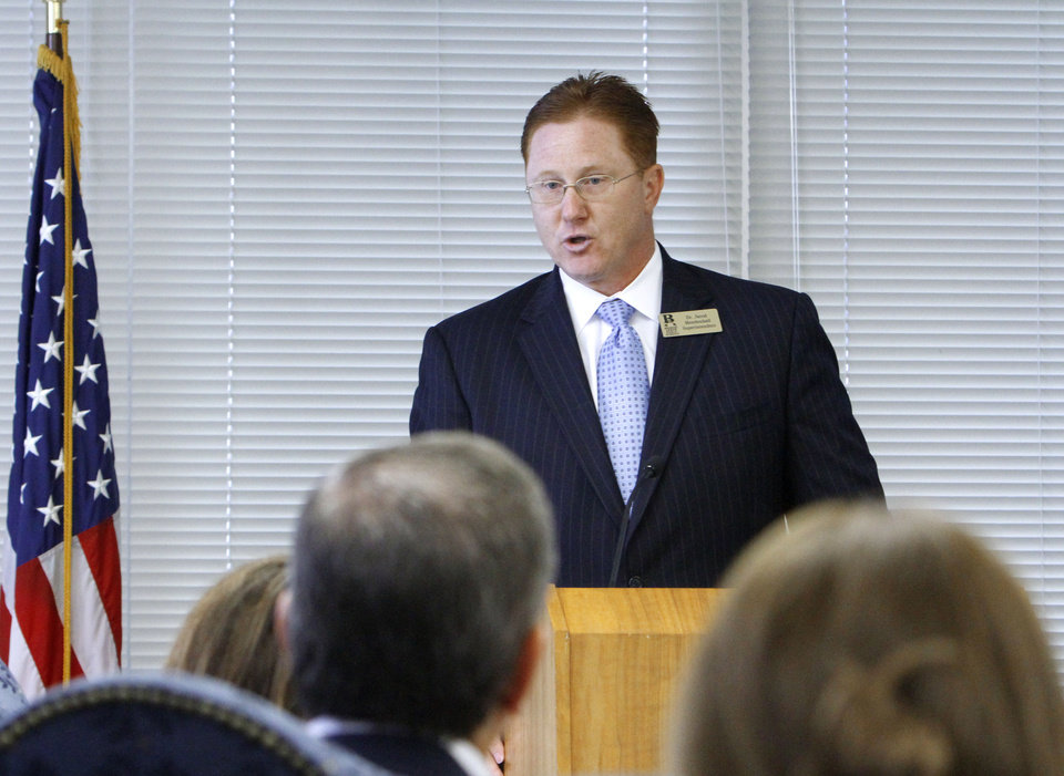 Photo - Broken Arrow Superintendent Jerod Mendenhall addresses the Board of Education deciding to grant high school diplomas to several Oklahoma students who failed state-mandated end-of-instuction exams, Tuesday, June 5, 2012.  Photo By David McDaniel/The Oklahoman