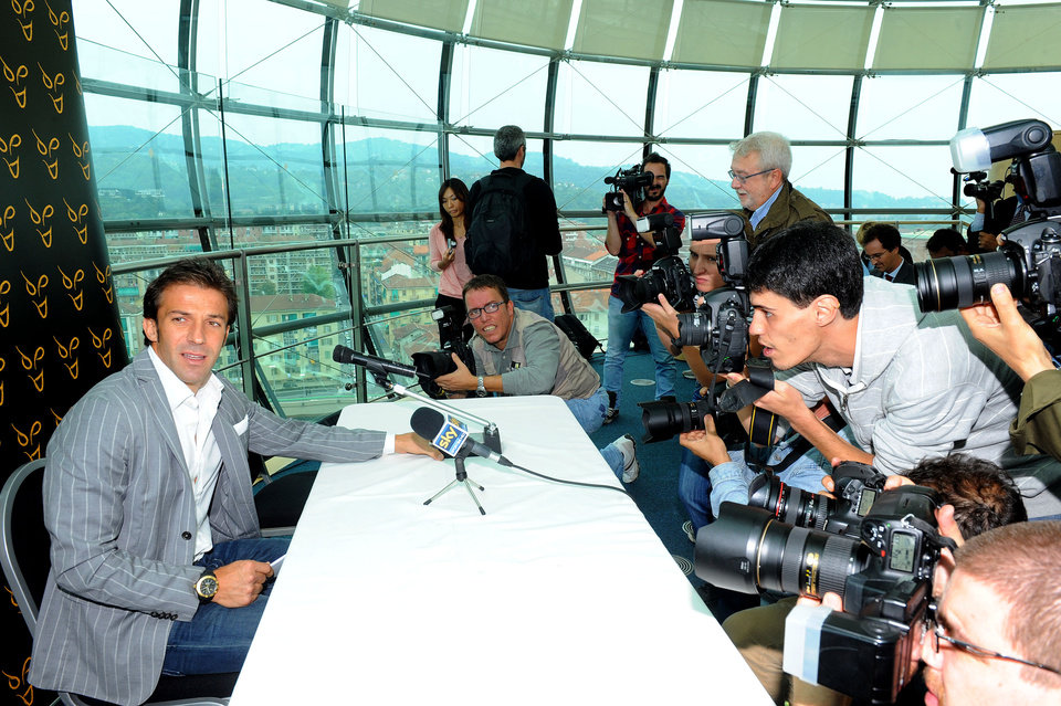 Photo -   Former Italy and Juventus forward Alessandro Del Piero is surrounded by photographers during a press conference at the Lingotto Palace in Turin, Italy,Wednesday, Sept. 5,2012. Del Piero is joining Sydney FC in a deal that will make him the highest-profile player in the A-League. The two-year deal is reportedly worth $2 million per season, which will make Del Piero the highest paid athlete in Australia's four football codes, including rugby league, rugby union and Australian Rules. The 37-year-old Del Piero reportedly turned down offers from English Premier League clubs Liverpool and Southampton. He was also linked with moves to the Middle East, China, Argentina, the United States and Switzerland. (AP Photo/Massimo Pinca)