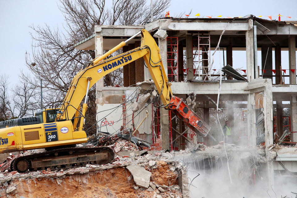 Photo -  Cold weather does not stop demolition of the former Oklahoma Wildlife Building. It will be replaced in 2018 by a new, larger building. [Photo by Doug Hoke, The Oklahoman]