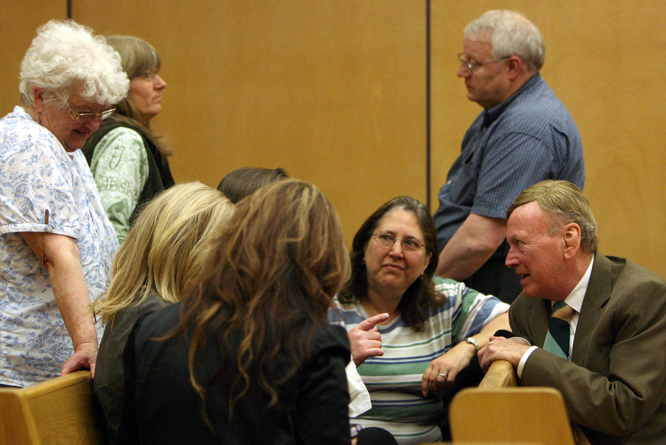 Photo -   Judy Cox, center, and Chuck Cox, standing, talk with family and friends during a break in the voyeurism trial of Steve Powell, Tuesday, May 15, 2012, in Tacoma, Wash. Powell is the father-in-law of missing Utah mother Susan Powell. Judy and Chuck Cox are the parents of Susan Powell. (AP Photo/The Salt Lake Tribune, Steve Griffin) DESERET NEWS OUT; LOCAL TV OUT; MAGS OUT