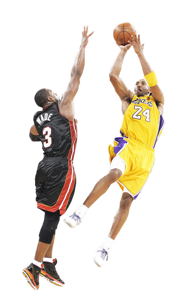 Photo - Lakers guard Kobe Bryant made a buzzer-beating 3-point bucket to beat the Miami Heat last week, 108-107. AP PHOTO